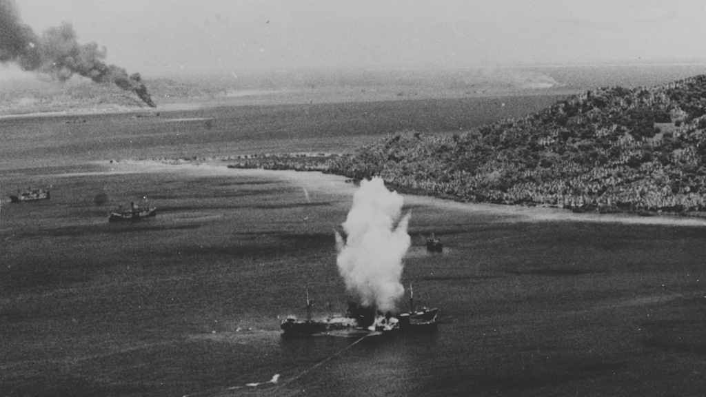 A Mark XIII aerial torpedo hits a Japanese cargo ship, during the first day of U.S. Navy carrier air raids on Truk, 17 February 1944. Note the several torpedo wakes, including one very erratic one ending with the torpedo broaching. Photographed by War Correspondent Smith. Official U.S. Navy Photograph, now in the collections of the National Archives.